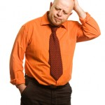 The comical fat man in an orange shirt